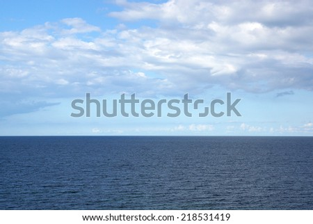 Ocean with blue sky and summer clouds