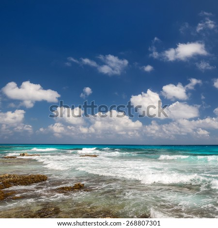 Ocean with waves and rocks on caribbean beach - stock photo