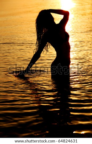 ocean woman in sunrise