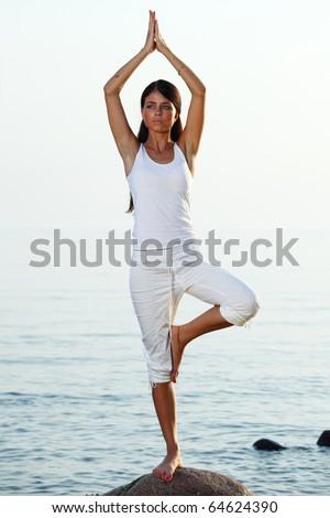 ocean yoga - stock photo