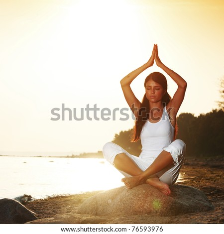 ocean yoga - stock photo