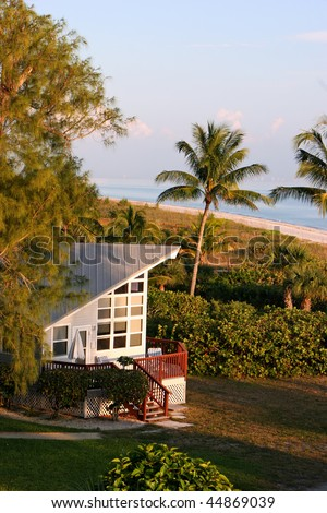oceanfront beach home at sunset Sanibel Florida - stock photo