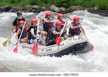 OCOEE, TENNESSEE - JULY 31: Unidentified persons enjoy a day of whitewater rafting on July 31, 2010 on the Ocoee River in Tennessee. - stock photo