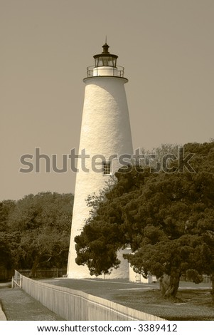 Ocracoke Lighthouse in Sepia Tones   Built in 1823, the Ocracoke Lighthouse is the oldest active lighthouse in North Carolina. Located in a fishing village on Ocracoke Island. - stock photo