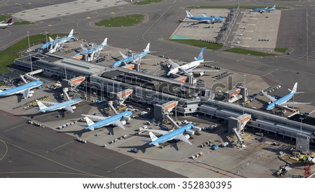 October 11, 2015, Amsterdam, Eight airplanes from KLM and one Airbus A380 from China Southern at the gate at Schiphol Airport.