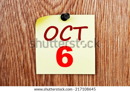 October 6 calendar. Note paper on a message board