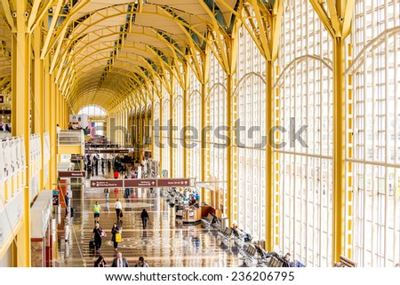 October 2, 2014: DCA, Reagan National Airport, Washington, DC - people on a moving walkway in a bright airport - stock photo