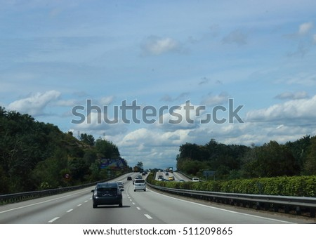 October 31, 2016.  Light traffic on the North-south highway from Melaka to Kuala Lumpur in Malaysia on a sunny day with beautiful clouds.