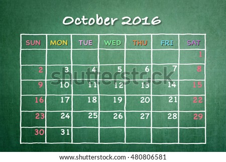 October 2016: Monthly calendar on green chalkboard background with colorful pastel day and date in freehand grid time table chalk drawing: School/ business time planner conceptual idea for new plan