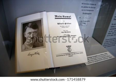 "OCTOBER 2010 - OBERSALZBERG: the book ""Mein Kampf"" (My Fight) by German Nazi dicator Adolf Hitler, exhibit in the documentary center on Nazi-Germany, Obersalzberg, Berchtesgaden, Bavaria, Germany. - stock photo"