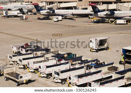 October 2, 2015, Phoenix, Arizona, USA - PHX airport. Luggage and carts on the ramp.