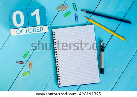 October 1st. Image of october 1 wooden color calendar on blue background. Autumn day. Empty space for text. World Vegetarian Day - stock photo