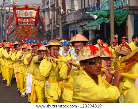OCTOBER 20: The Burning King Boat Ceremony in DongGang, Taiwan on October 20, 2012. The believers move the King Boat around the downtown of Donggang. - stock photo