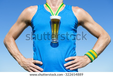 Octoberfest athlete standing with first place gold medal in the shape of a glass of beer standing in front of blue sky - stock photo