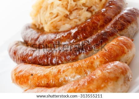 Octoberfest menu, plate of sausages and sauerkraut. Oktoberfest meal. - stock photo