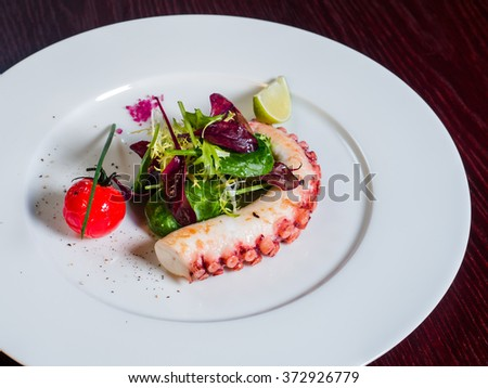 octopus salad and cherry tomatoes