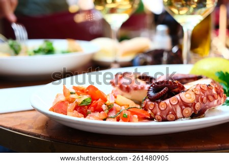 Octopus salad close up. Shallow depth of field. No brandnames or copyright objects.  - stock photo