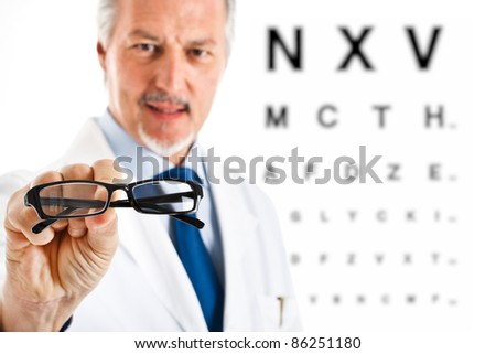 Oculist giving you a pair of glasses - stock photo