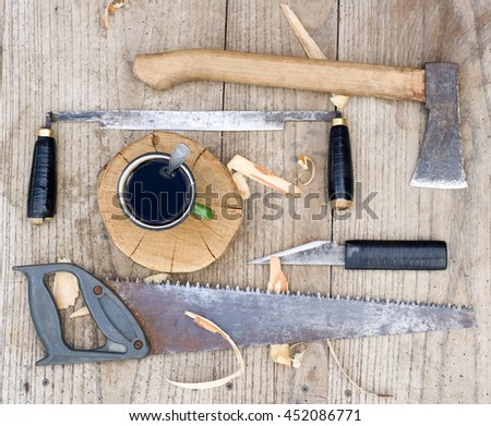 Od vintage hand tools on wooden background. Carpenter workplace - stock photo