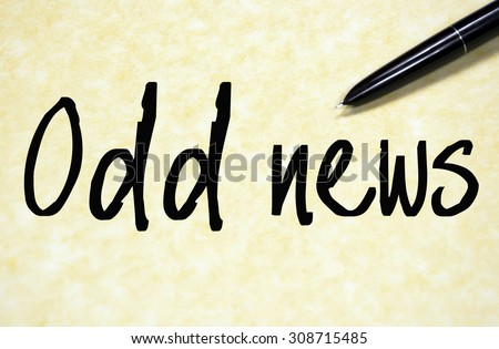 odd news text write on paper  - stock photo