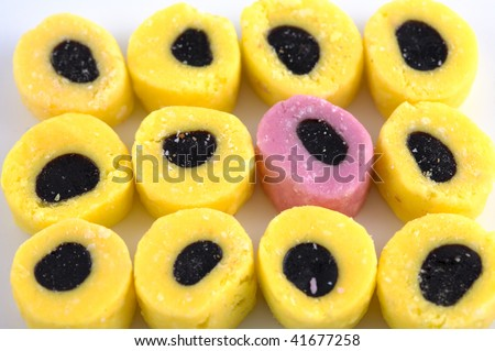 Odd one out licorice allsorts - stock photo