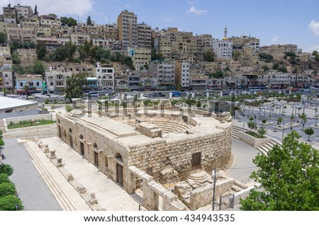 Odeon - little roman amphitheatre in downtown with cityscape background, Amman, Jordan
