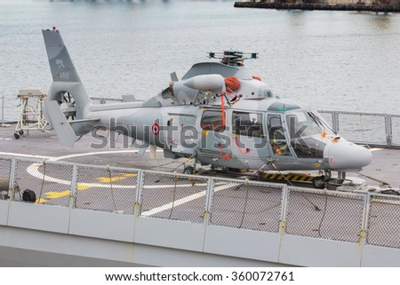 Odesa, UKRAINE - MARCH, 26, 2015: helicopter on the deck of a warship - stock photo