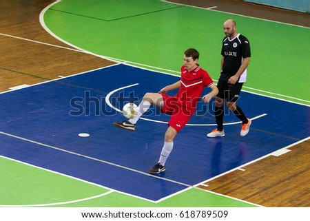 ODESSA, UKRAINE - April 7, 2017: Football on floor, minifootball.  Regional tournament of local clubs on futsal. bright moment of sports game mini football in closed hall