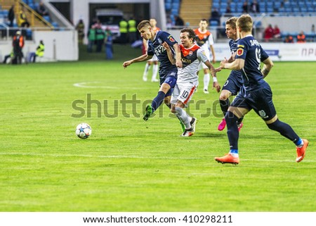 "ODESSA, UKRAINE - April 23, 2016: Football Team Super Champions League ""Shakhtar"" - Donetsk and ""Chernomorets"" - Odessa. Tense game tough rivals on the football field. League Pari-Match"