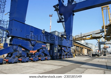 ODESSA, UKRAINE - APRIL 15: industrial sea cargo cranes on the dock harbor of Odessa Sea Commercial Port of loading in Odessa marine vessel cargo container terminal , April 15, 2014 Odessa, Ukraine