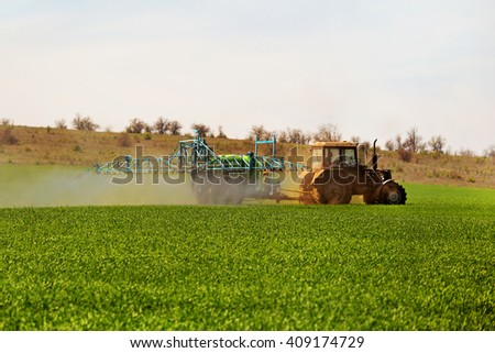 Odessa, Ukraine - April 17, 2016: Shot of the employee performing maintenance on the green field. April 17, Odessa, Ukraine