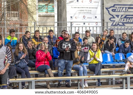 ODESSA, UKRAINE - April 9, 2016: Spectators and fans in the stands of the teams during  Futsal Championship. The first match on the new playground Municipal Sports Club mini-football will be held. - stock photo