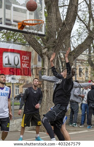 ODESSA, UKRAINE - April 9, 2016: Streetball at the opening of the summer season of street sports. Street basketball players fighting for the ball in the city championship