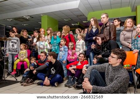 Odessa, Ukraine - April 4, 2015: The audience at a private concert during the creative light and music show fashionable jazz band in a small room. Emotionally. - stock photo