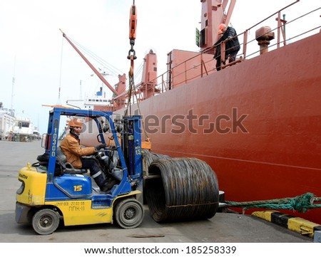 ODESSA, UKRAINE - 12 April : The loading of a cargo ship at dock in Odessa seaport. Mechanized metal work truck , April 12, 2013 Odessa, Ukraine