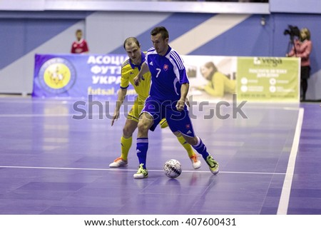 Odessa, Ukraine - April 12, 2016: World Cup play-off match UKRAINE -SLOVAKIYA. Playing futsal. Mini soccer on the big stage of the sports hall covering modern playground