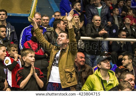 Odessa, Ukraine - April 12, 2016: World Cup playoff match UKRAINE -SLOVAKIYA. The game of mini-soccer. Mini-soccer on big stage of sports hall. Spectators celebrate the victory of the national team