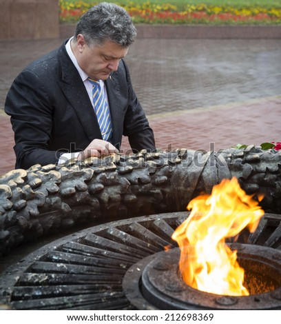 ODESSA, UKRAINE - Aug 24, 2014: President of Ukraine Petro Poroshenko mourn the dead near the eternal flame during the celebration of the 23rd anniversary of the Independence of Ukraine