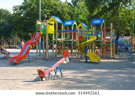 ODESSA, UKRAINE - August 17, 2015: Colorful playground fun  day ice set joy kid cold baby park blue play game slide green place color climb empty child happy nobody season ladder nature ground outdoor
