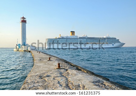 Odessa, Ukraine, August 23, 2013. Cruise ship Costa Deliziosa sailing from Odessa sea port and Vorontsovsky lighthouse. - stock photo