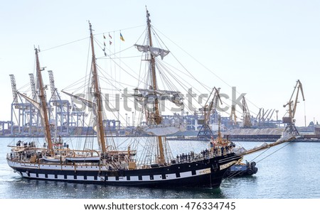 "Odessa, Ukraine August 15, 2016: Education barquentine Italian Navy ""Palinuro"" moored at pier of the Odessa Commercial Sea Port in Odessa. Sailing ship with tall masts comes to sea port"