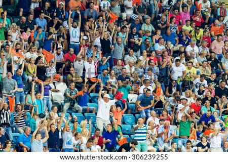 ODESSA, UKRAINE - 14 August, 2015: Football fans and spectators in stands of  stadium emotionally support their team during game of FC Shakhtar (Donetsk) - Dnipro (Dnipropetrovsk).  Ukrainian Cup - stock photo