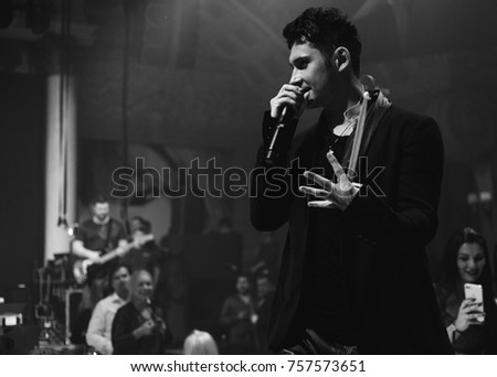 Odessa, Ukraine December 31, 2016: Artist Dan Balan performs songs and club show from stage during concert at nightclub. Artist on club stage during night party.