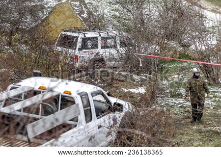 Odessa, Ukraine - December 6, 2014: Off-road 4x4 cars on the road passes sport routes in the winter mountains close-up, December 6, 2014 in Odessa, Ukraine.