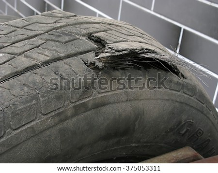 Odessa, Ukraine, February 10, 2016 -: Broken car wheel for tire in the city center. - stock photo