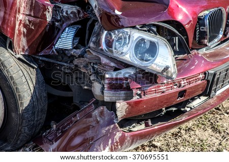 Odessa, Ukraine - February 19, 2015: Red Car Crash. The driver at high speed lost control after hitting a hole in the road. Bad road.