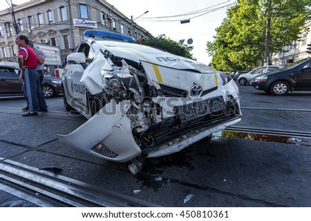 ODESSA, UKRAINE - July 11, 2016: Crash accident on the street with a police crew. Police car during the chase the offender lost control and created a major accident. Broken car in the collision - stock photo