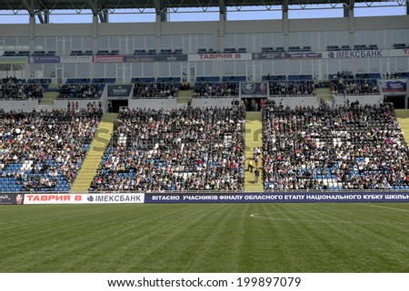 ODESSA, UKRAINE - July 10, 2013: emotional football fans support the team at the stadium during a game of football club Chernomorets, July 10, 2013, Odessa, Ukraine - stock photo