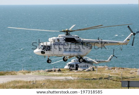 ODESSA, UKRAINE - JULY 04: military government MI-8 helicopter makes a landing on the island of Serpents (ZMEINUI) working in normal mode July 4, 2008 in Odessa, Ukraine. - stock photo