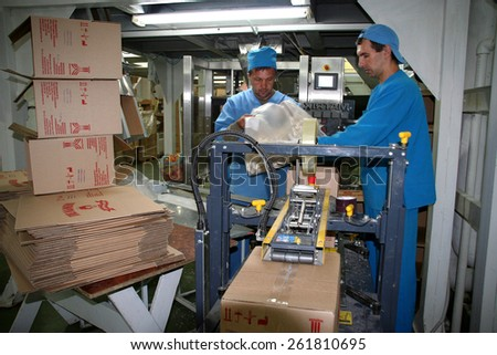 Odessa, Ukraine - July 7, 2007: The factory for the production of food from natural Ingredients. Food Convenience food. Production of dumplings, pancakes. Line of packaging and shipping - stock photo